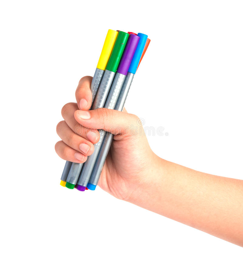 Vrouwenhand die magische die kleurenpennen houden op wit worden geïsoleerd royalty-vrije stock afbeeldingen