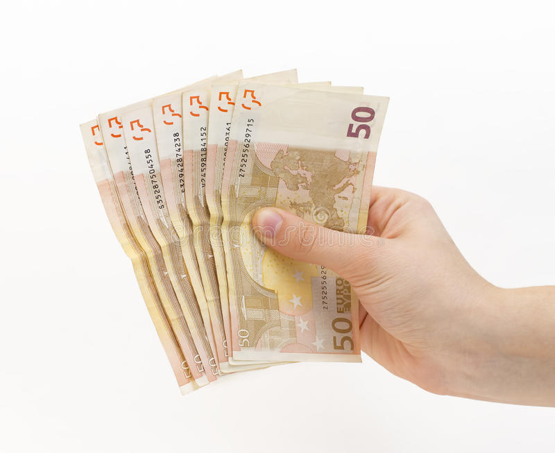 Vrouwenhand met (euro) geld stock afbeeldingen