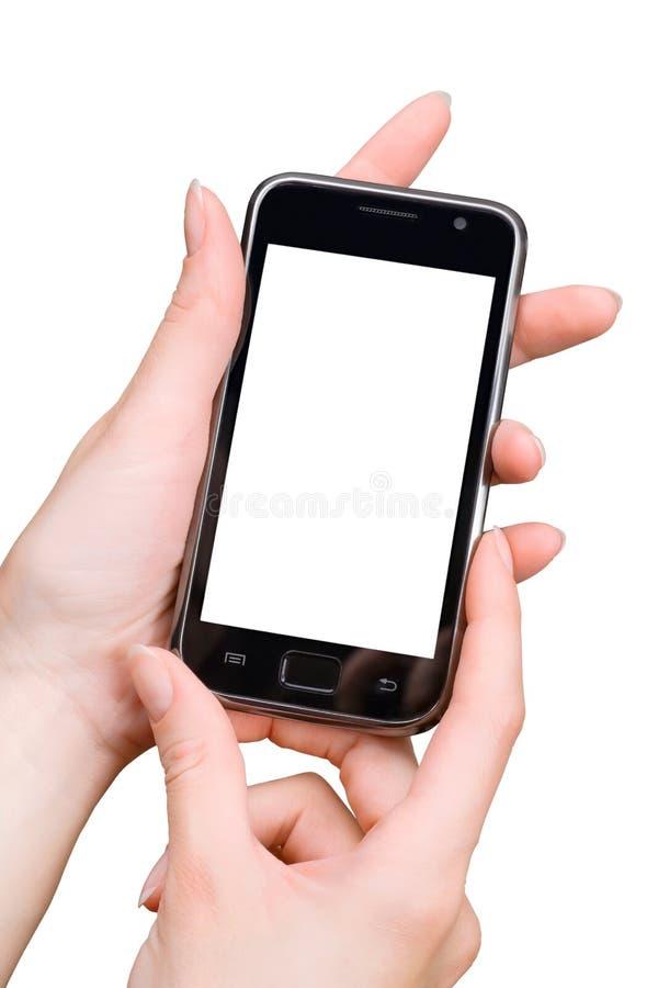 Vrouwenhanden die smartphone gebruiken Geïsoleerd op wit met exemplaarruimte stock foto's
