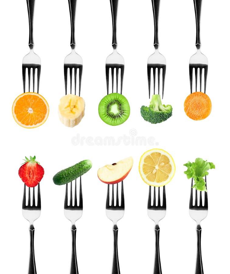 Vruchten en groenten op de vorken royalty-vrije stock foto