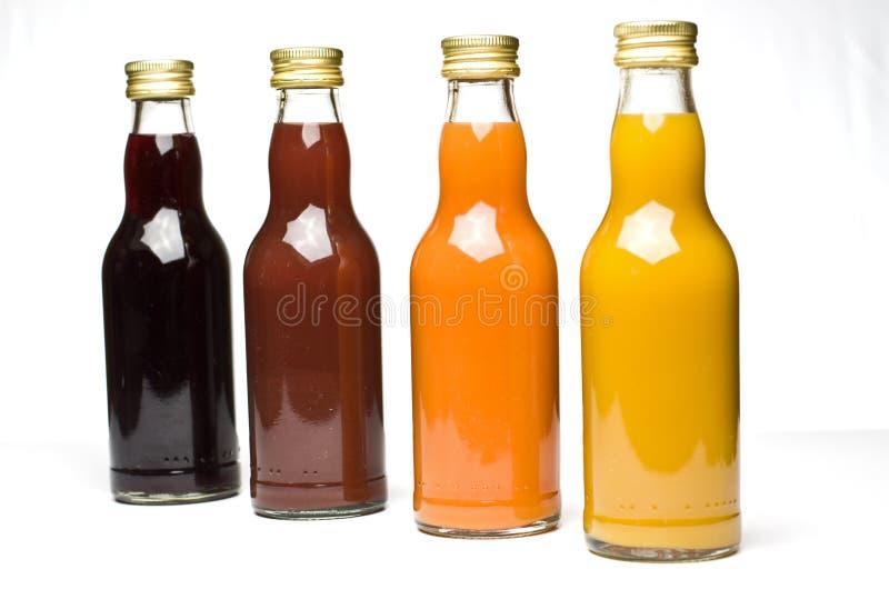 Vruchtesap in flessen royalty-vrije stock foto