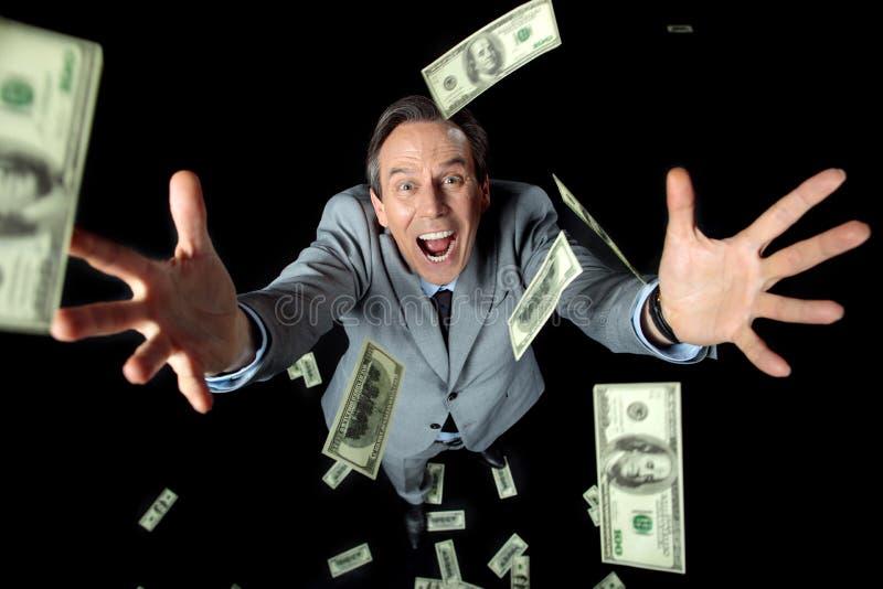 Vue aérienne des billets de banque contagieux du dollar d'homme d'affaires enthousiaste photo libre de droits