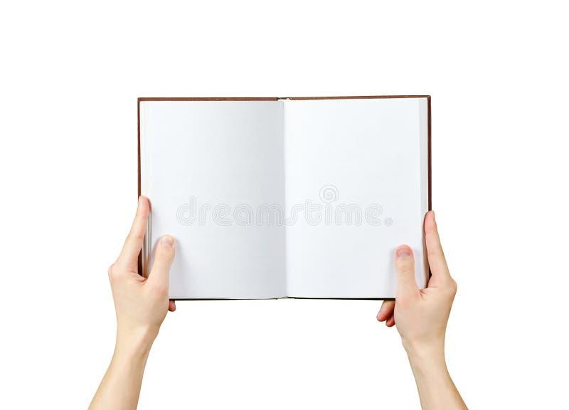 Vue aérienne des mains jugeant un livre vide prêt avec le spac de copie images libres de droits
