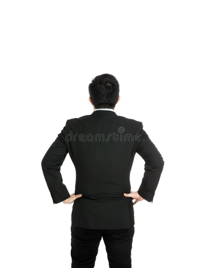 Vue arrière avec la main d'homme d'affaires sur la hanche photos stock