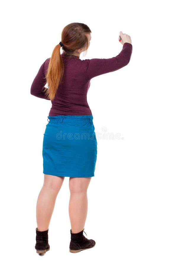 Vue arrière d'écrire la belle femme Jeune fille dans la robe image stock