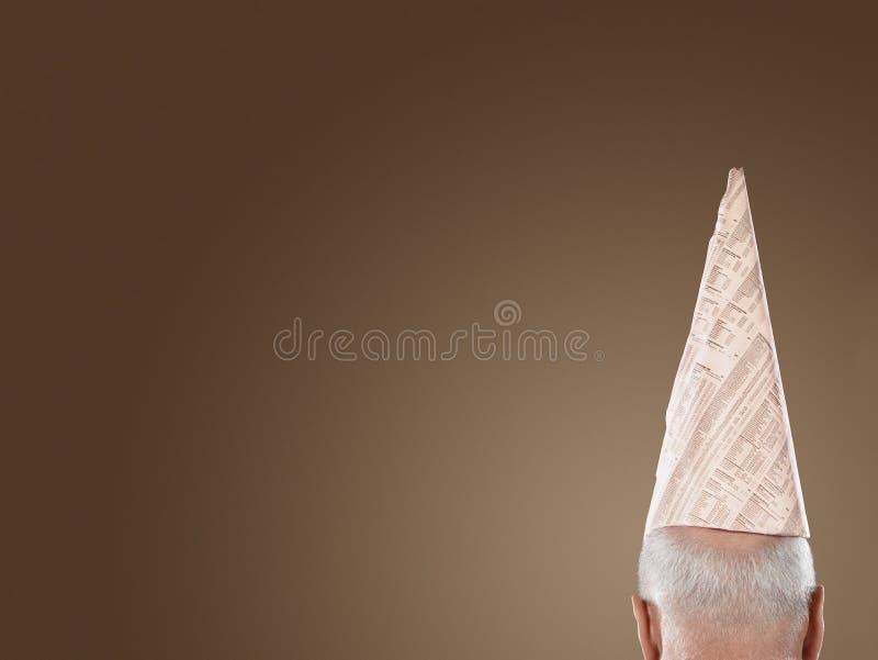 Vue arrière d'homme d'affaires Wearing Dunce Hat photos libres de droits