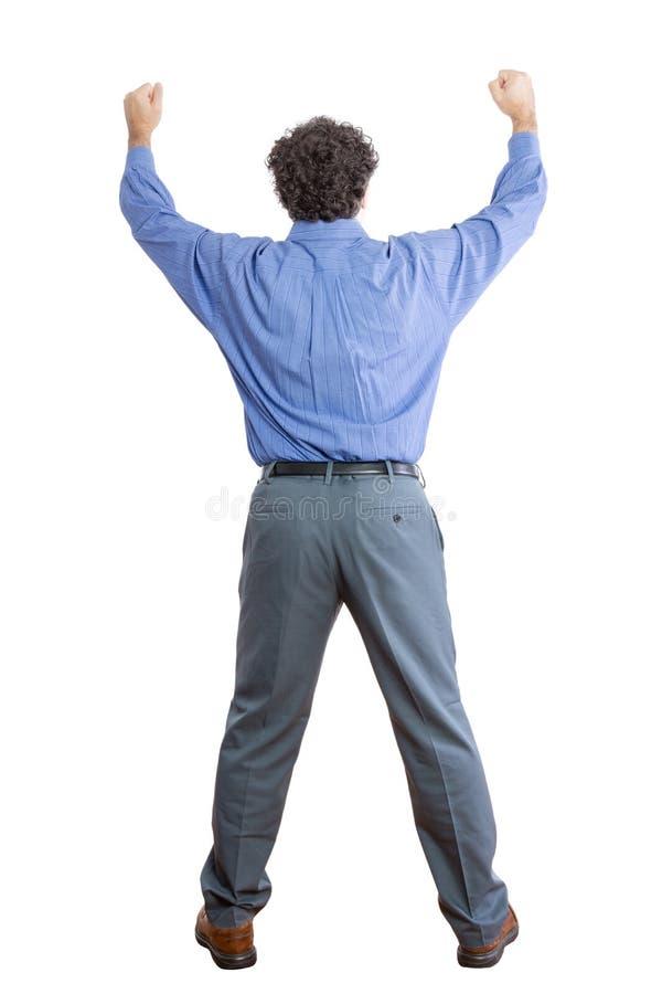 Vue arrière d'un homme d'affaires Raising ses poings photo libre de droits