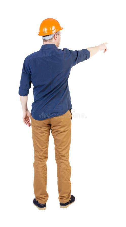 Vue arrière de diriger des jeunes hommes dans la chemise et le casque photographie stock libre de droits