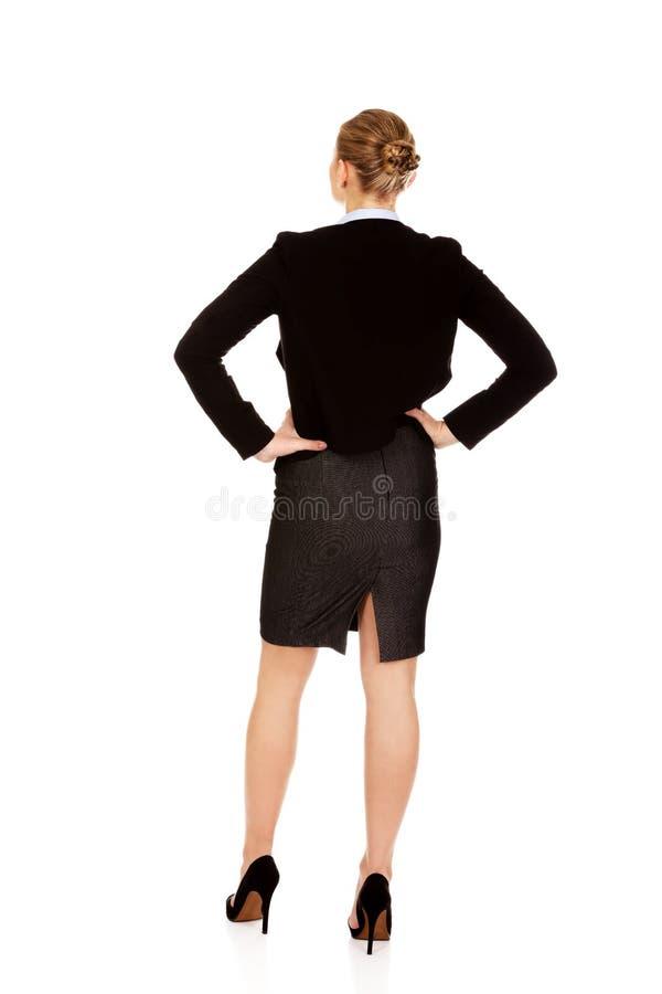 Vue arrière de femme élégante de businsess photos libres de droits