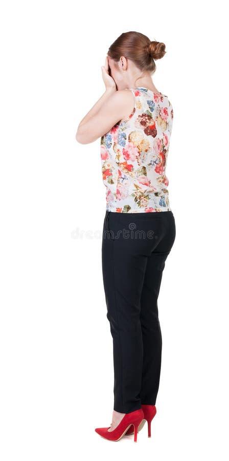 Vue arrière de femme choquée dans des pantalons photo libre de droits