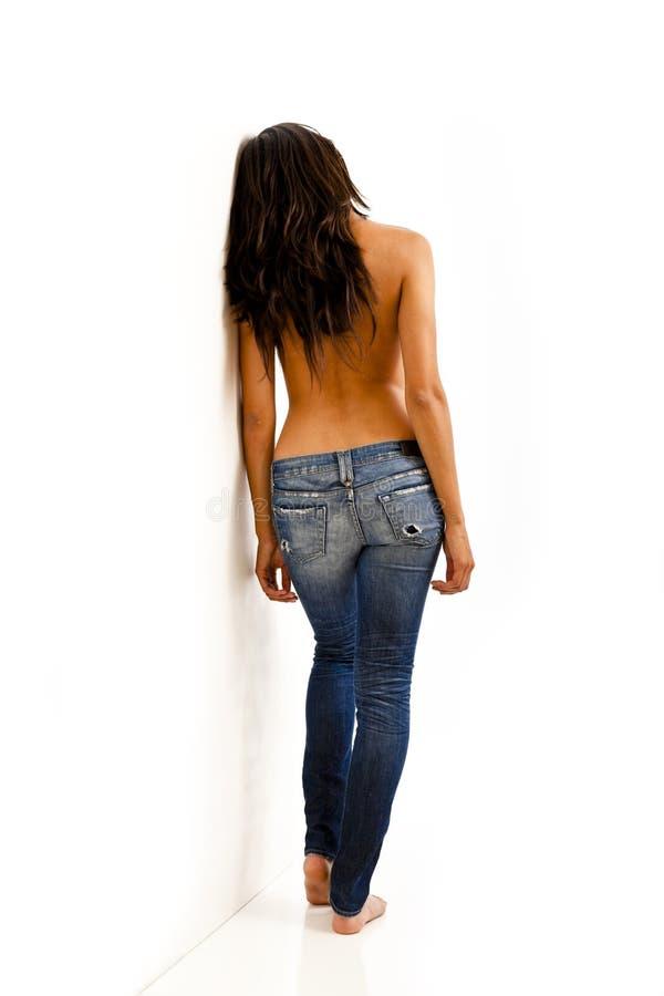 Vue arrière de femme dans des jeans photos stock