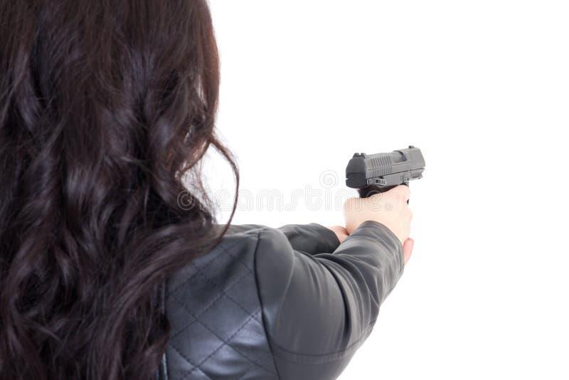 Vue arrière de femme jugeant l'arme à feu d'isolement sur le blanc photos libres de droits
