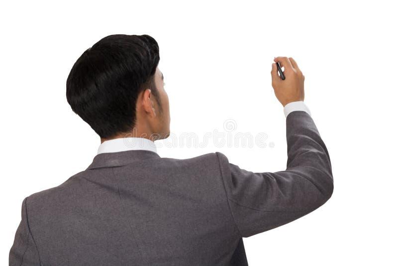 vue arrière de l'écriture d'homme d'affaires, dessin sur l'espace vide images stock