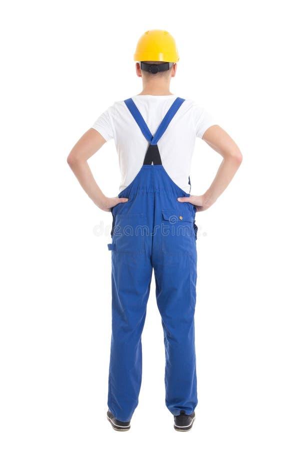 Vue arrière de l'homme dans l'uniforme de constructeur d'isolement sur le blanc photographie stock libre de droits