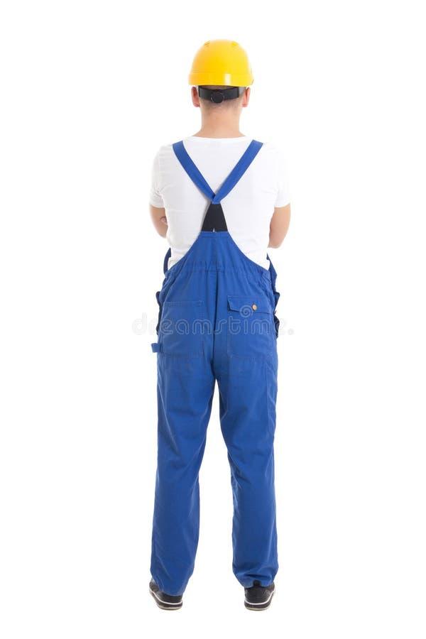 Vue arrière de l'homme dans l'uniforme de constructeur et du casque d'isolement sur le blanc images libres de droits