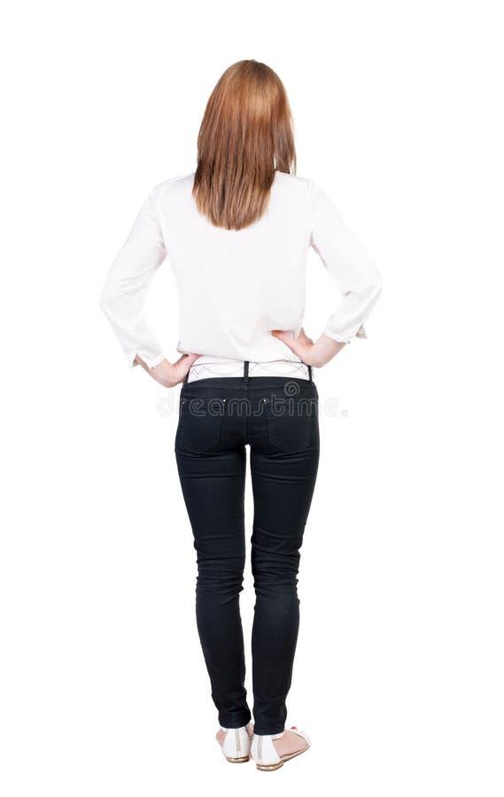 Vue arrière de tenir la jeune belle femme de brune photos libres de droits