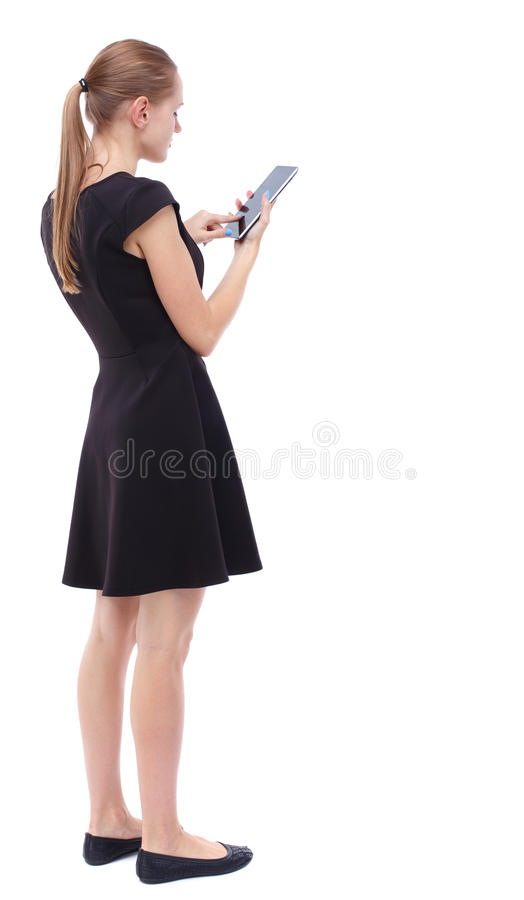 Vue arrière de tenir la jeune belle femme et d'employer un mobile images stock