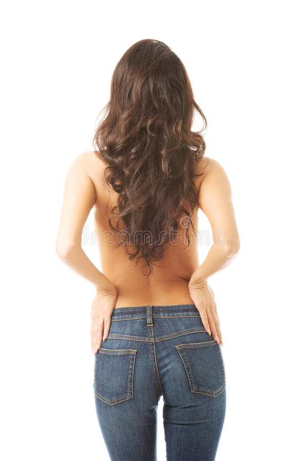 Vue arrière des jeans de port sans chemise de femme photographie stock libre de droits