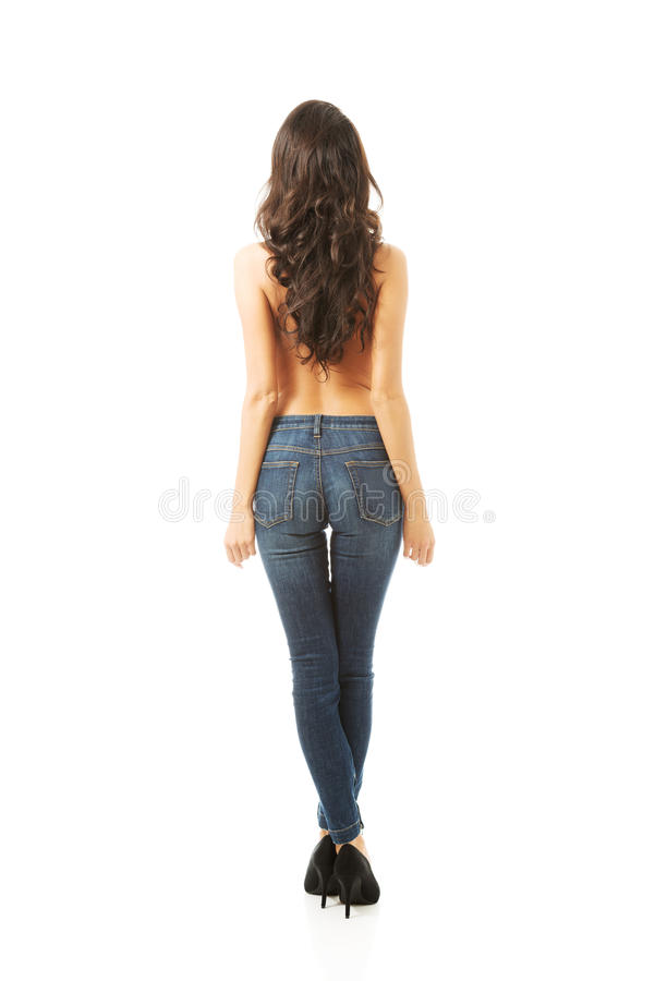 Vue arrière des jeans de port sans chemise de femme photos stock