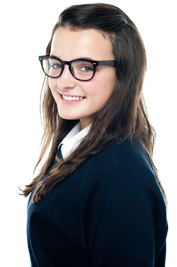 Vue de côté d'un adolescent adorable image libre de droits