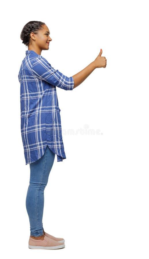 Vue de côté d'un pouce d'apparence de femme de couleur  photo libre de droits