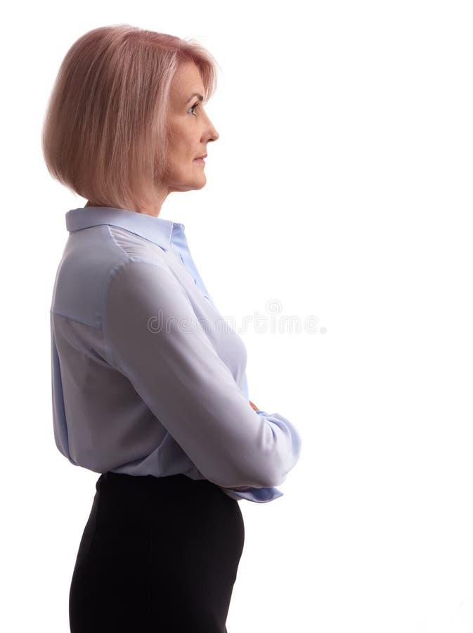Vue de côté d'une vieille femme d'affaires photographie stock libre de droits