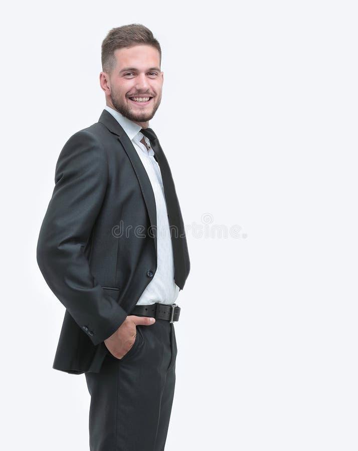 Vue de côté Homme d'affaires de sourire regardant l'appareil-photo photo stock