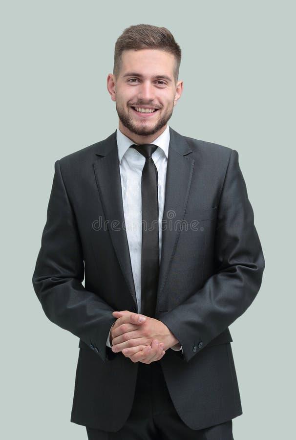 Vue de côté Homme d'affaires de sourire regardant l'appareil-photo images stock
