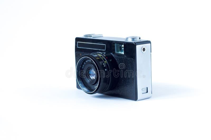 Vue de côté de vieil appareil-photo de film Plan rapproché blanc de fond Photo de cru image stock