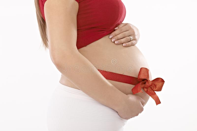 Vue de côté de ventre enceinte photos libres de droits