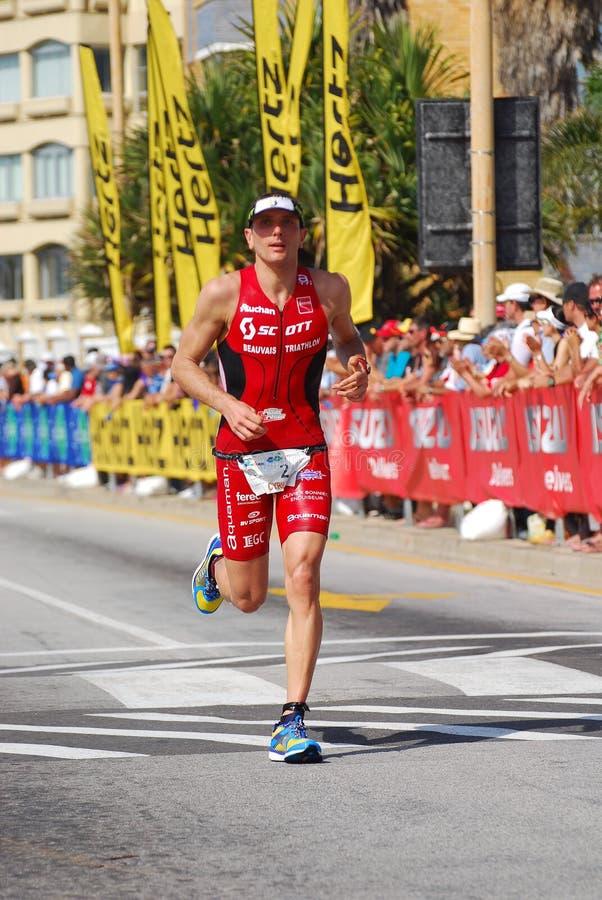 Fonctionnement professionnel de triathlete d'Ironman photographie stock