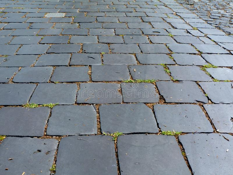 vue de perspective d'abrégé sur lâchement réglé trottoir de pierre de pavé de granit image libre de droits