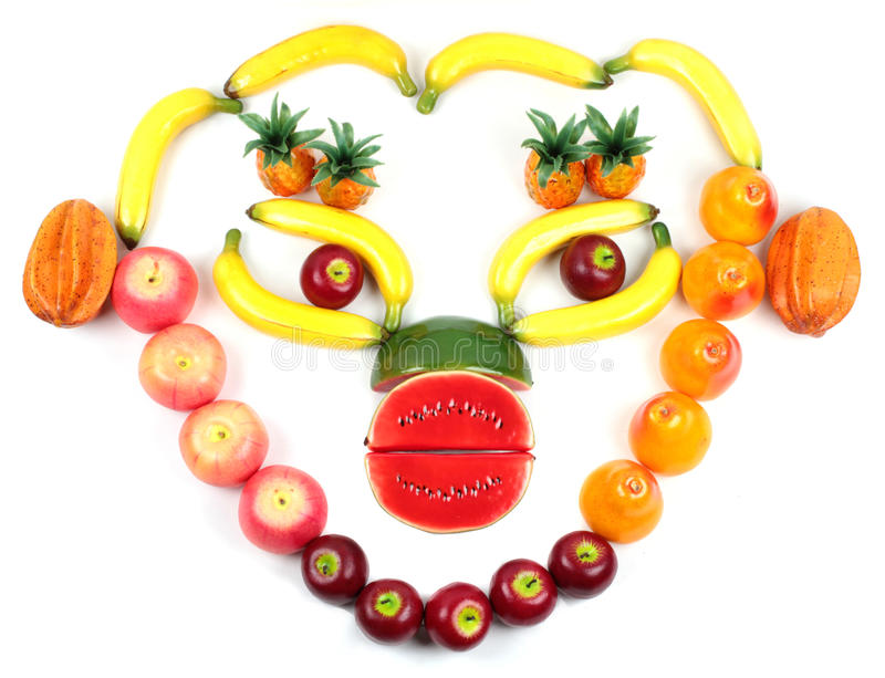Vue de visage humain avec l'assortiment de divers fruits photographie stock