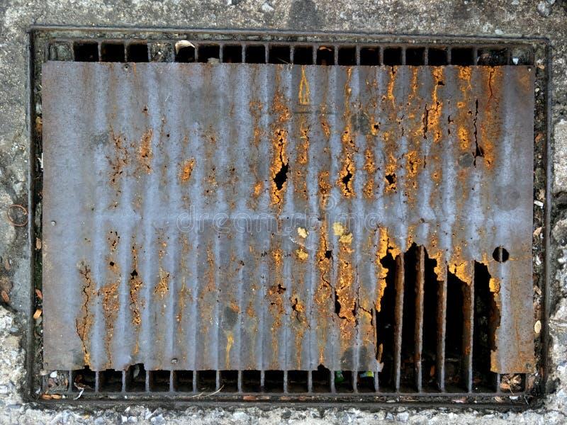 Vue supérieure Backgound de vieille en métal de rue de l'eau d'égout texture de couverture photos stock