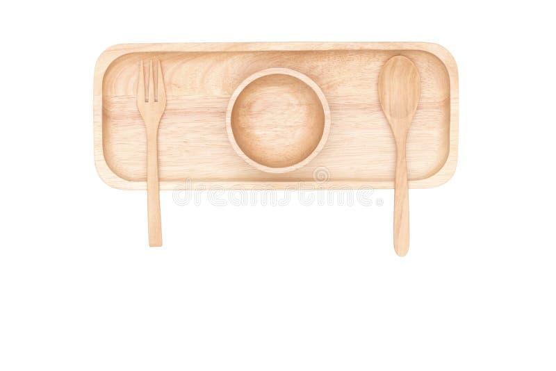 Vue supérieure : cuillère en bois et tasse en bois placées sur le plateau en bois photos libres de droits