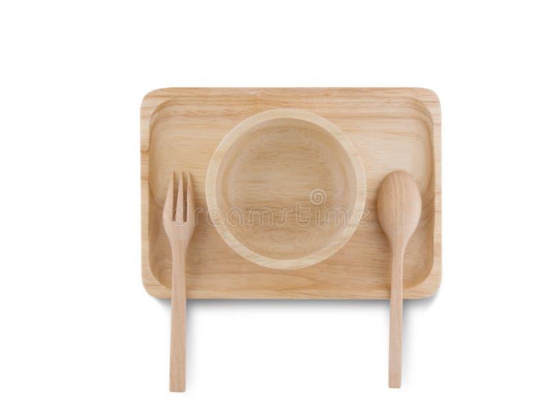 Vue supérieure, cuillère en bois et tasse en bois placées sur le plateau en bois photos libres de droits