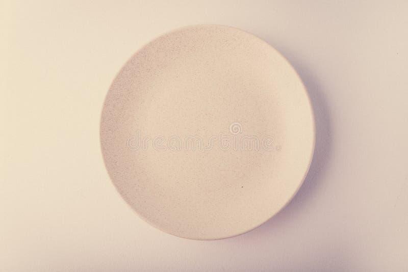 Vue supérieure d'un plat en pastel sur un fond en pastel de pêche Photographie de nourriture de minimalisme Style géométrique photos stock