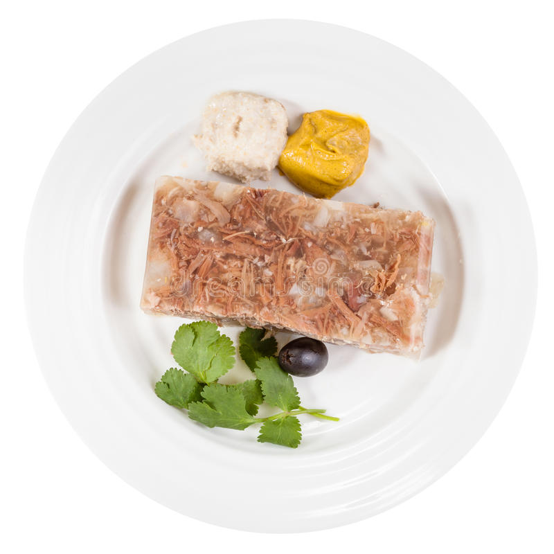 Vue supérieure de la partie de l'aspic de viande du plat blanc photographie stock libre de droits