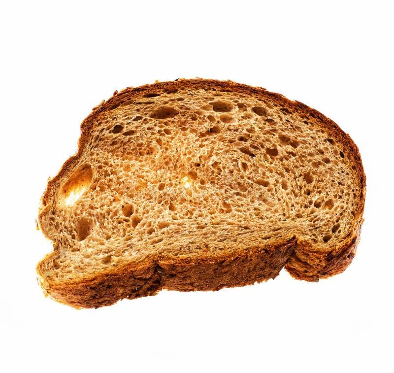 Vue supérieure de la tranche de pain entier d'isolement au-dessus du fond blanc images stock