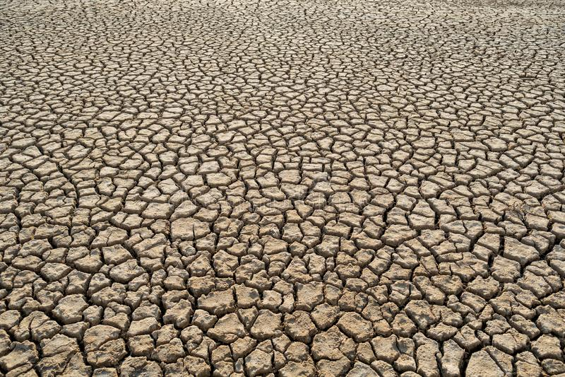 Vue supérieure de modèle de texture de réchauffement global d'argile de saleté de la chaleur de désert image libre de droits