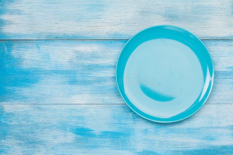 Vue supérieure de plat vide bleu images stock