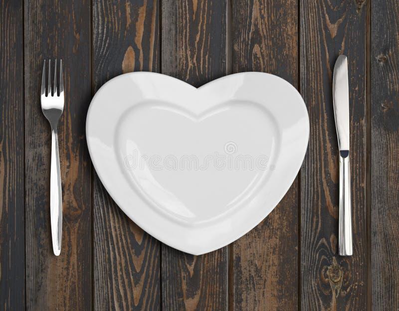 Vue supérieure de plat vide de coeur sur la table en bois image libre de droits