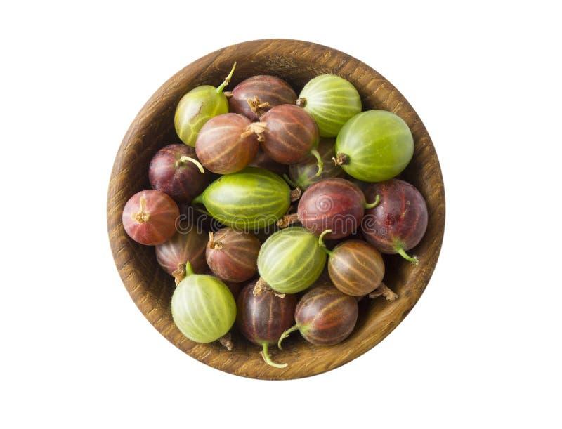 Vue supérieure Fruits de groseilles à maquereau sur le fond blanc Cuvettes avec des groseilles à maquereau d'isolement sur le fon image stock