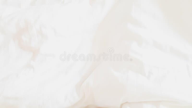 Vue supérieure - textures et modèles abstraits de fond de tissu de feuille de literie avec la lumière du soleil douce dans la cha illustration stock