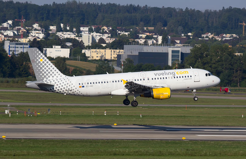 A-320 Vueling. ZURICH - AUGUST 23: A-320 Vueling landing in Zurich airport after short haul flight on July 18, 2015 in Zurich, Switzerland. Vueling is one of the royalty free stock photo