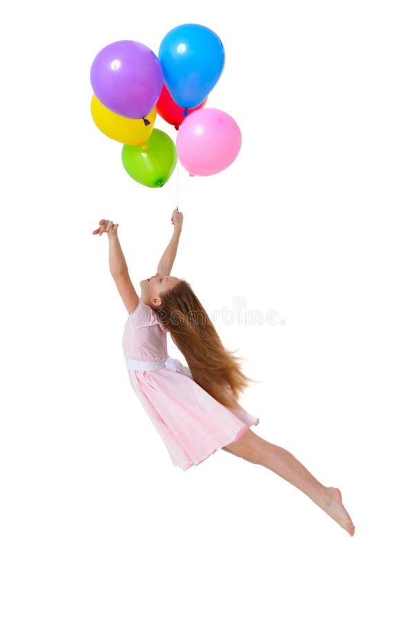 Vuelo de la muchacha con los globos imágenes de archivo libres de regalías