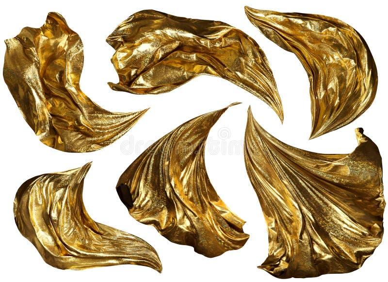 Vuelo de oro de la tela en el viento, paño del brillo del oro que agita que fluye fotos de archivo