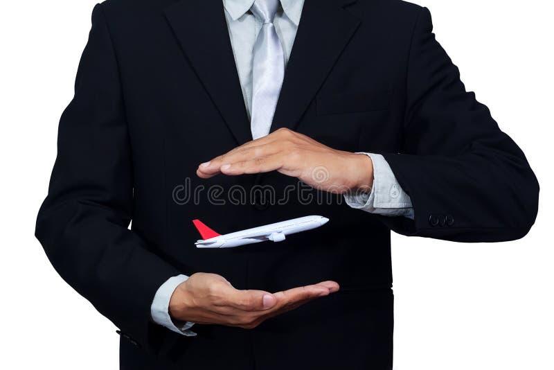 Vuelo del aeroplano a disposición del hombre de negocios, en blanco fotos de archivo