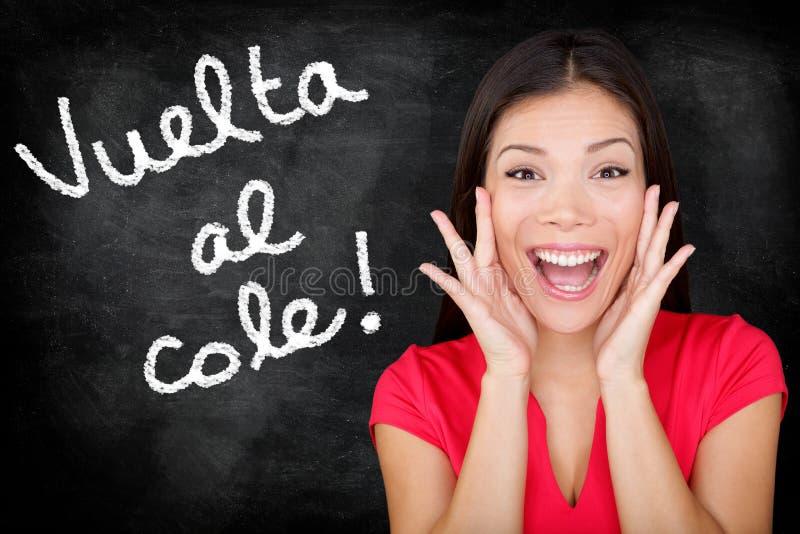 Vuelta al cole - Spanish student back to school. Vuelta al cole - Spanish student screaming Back to School written in Spanish on blackboard by woman teacher royalty free stock photos