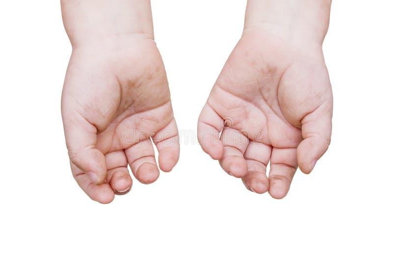 Vuile handen van kind stock foto